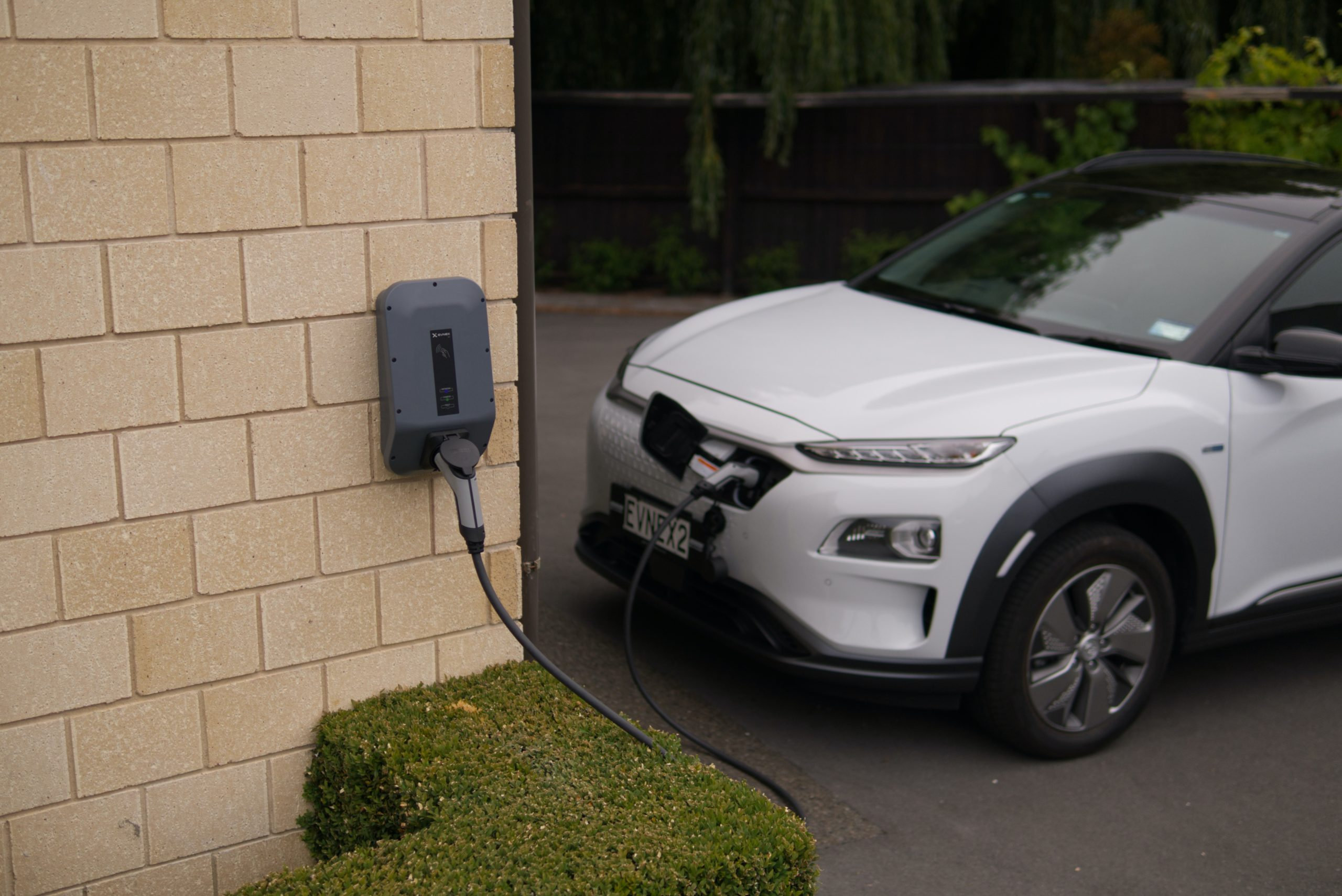 A EV car charging from a home wall system